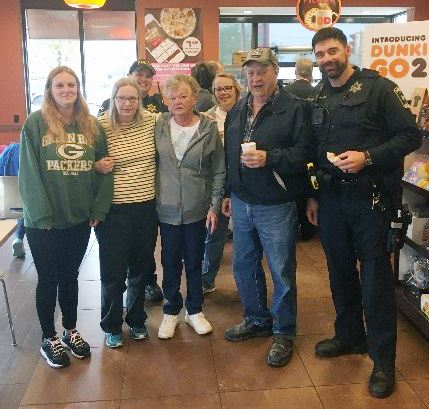 Group at Coffee Shop with Police Officer